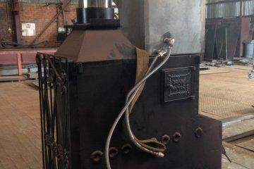 Металлическая печь для бани с баком
