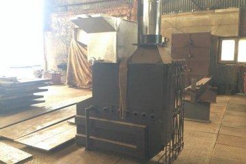 Металлическая печь для обогрева бани